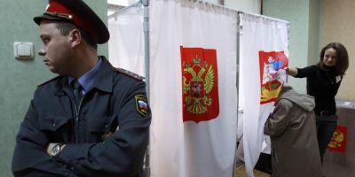 Rusii au inceput sa voteze in alegerile prezidentiale